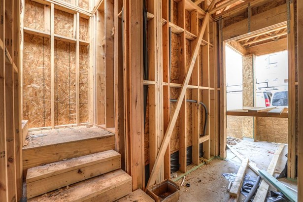 """Photo of a similar completed home in another community completed by City Choice Homes. Upon entry you are greeted with a wide stair hall with stained Oak Wood steps to 2nd level. Entry way finished in 12""""x24"""" marble look Porcelain floors. Solid wooden doo (photo 4)"""