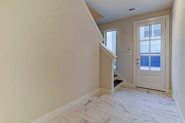 Photo of a similar completed home in another community completed by City Choice Homes. Guest Bedroom (10'x10') on main level with large double pane low-E windows providing excellent natural light. Putty Grey pin drop carpet contrasts neutral tones and alu (photo 5)
