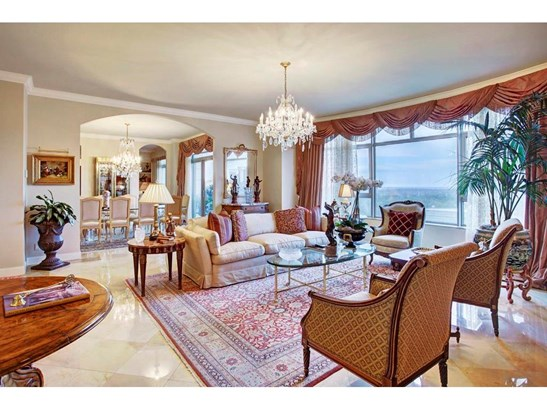 A spacious and spectacular Formal Living area is adorned with high ceilings, marble flooring and a wide, arched opening to the Formal Dining Room. (photo 2)