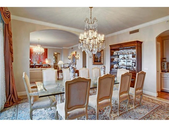 The Formal Dining Room is quite spacious and easily accommodates a large dining table and hutch. (photo 5)