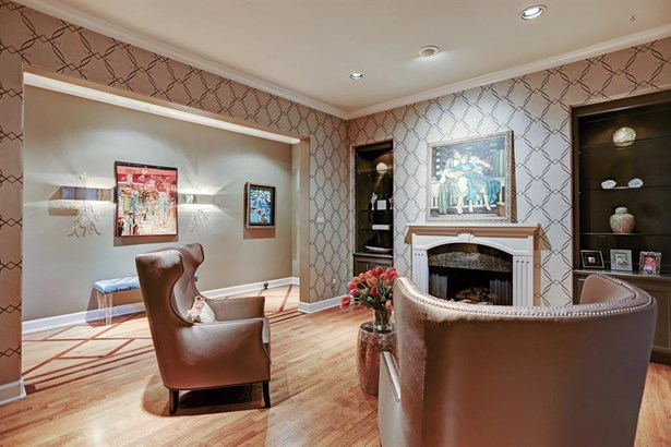 Right as you walk in you are greeted by the gorgeous formal living room. The room features a gas fireplace, hardwood floors and great built in shelves for any photos/artwork you may have! (photo 5)