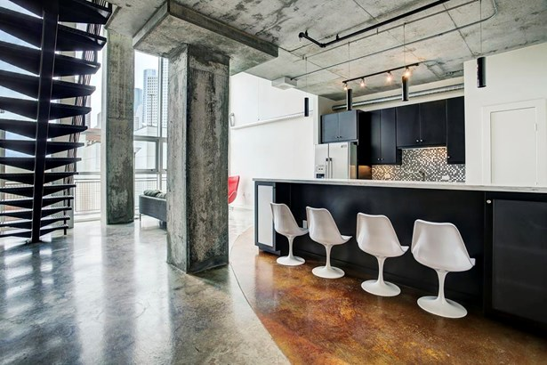 Offering all the expected architectural features of a mid/downtown loft, this home is sure to impress. (photo 1)