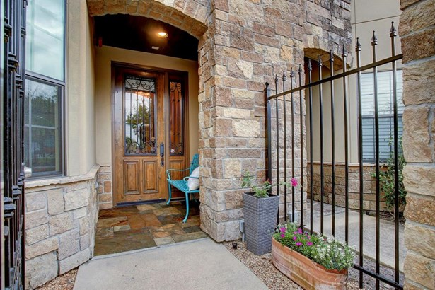 Front fenced entrance with beautiful Alden wood entry door, wrought iron accents and glass panels (photo 3)