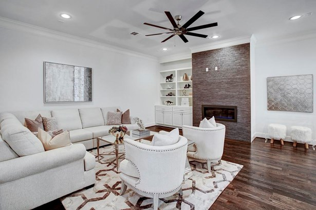 Spaciousness throughout this beautiful home. Open first floor layout with large living room. Linear gas fireplace, custom cabinetry, and tons of space to entertain. (photo 4)