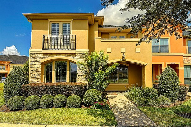 2 story stone & stucco townhome in gated lake community. (photo 1)
