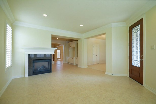 14x17 Living room opens to dining room and den. (photo 5)