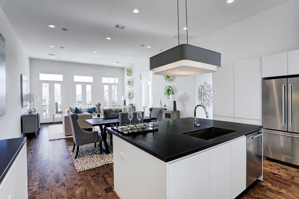 Here is a view from your beautiful island kitchen. The open concept is perfect for entertaining a large group of guests or experimenting with a new recipe all for yourself! (photo 1)