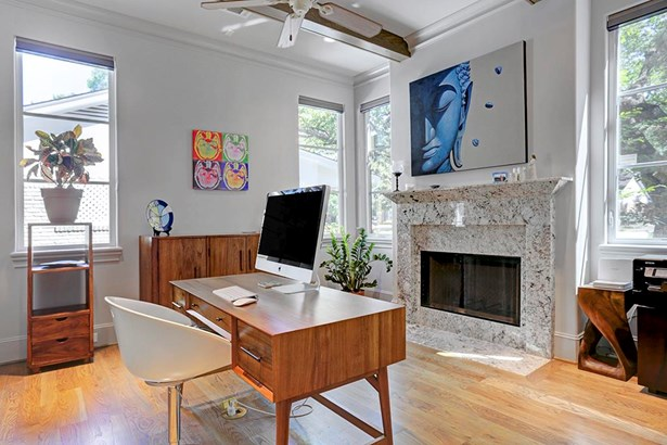 The natural light pores in the study off front entry way. Accent ceiling wood beams, wood floors, floor electric plugs and pretty fireplace mantle are featured too. (photo 4)
