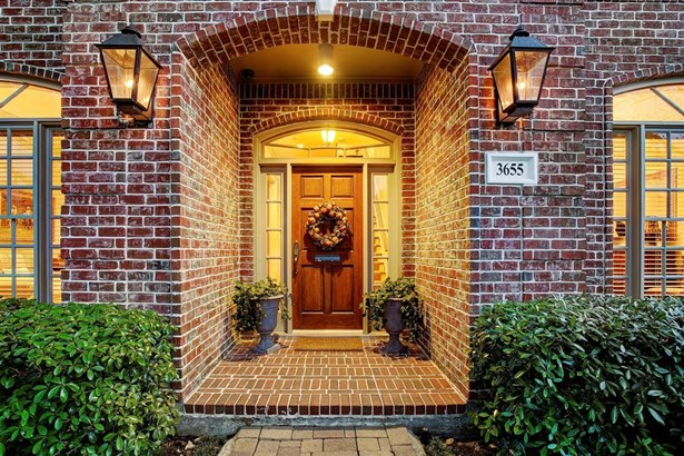 Warm and inviting covered entry to home along with intricate brickwork. Gracious brick façade, pavered walkway and gas lanterns greet you! (photo 1)