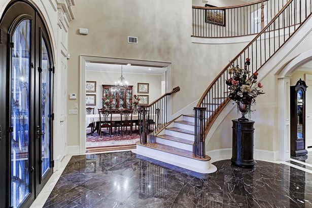2 story Entry with marble floors, grand staircase, and double doors! (photo 3)