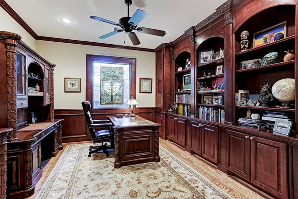 Formal Study featuring great built-ins, good storage, hardwood floors, crown molding, and fabulous detail work. (photo 5)
