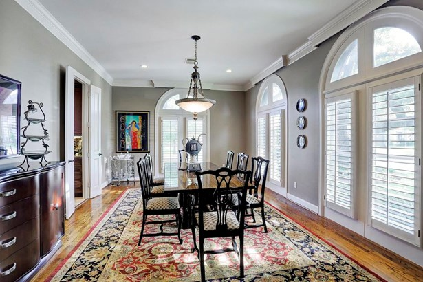 The formal dining room with beautiful plantation shutters over wrap around windows offer plenty of natural light. The room is large enough for oversized furniture and great for holiday entertaining! (photo 3)