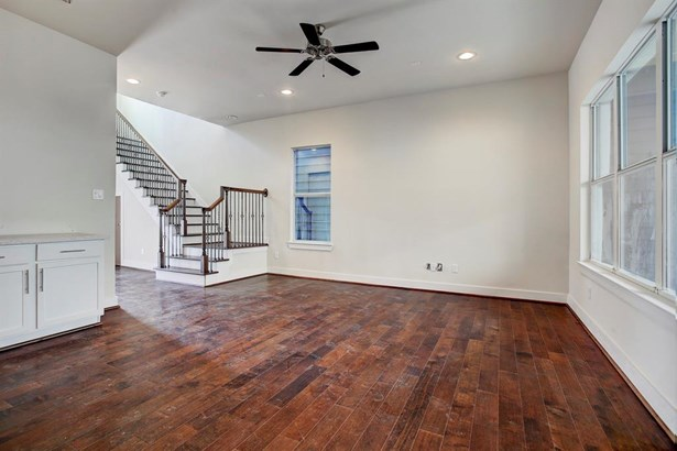 Upon entering the home you and your guests will be greeted at a Solid Mahogany Door, engineered wood floors and iron railing stair case. (photo 5)