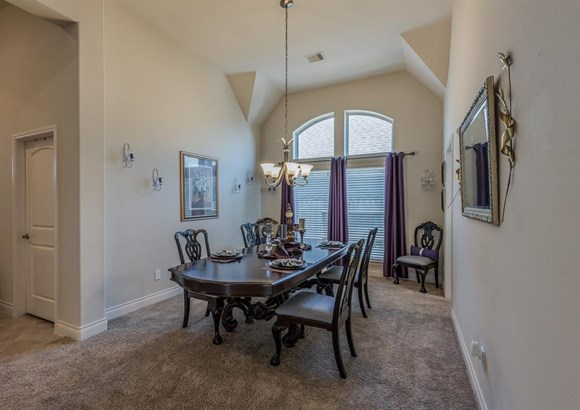Graceful elegance in this formal dining room with high ceilings and tall double windows provide a peaceful and private space to entertain dinner guests. (photo 3)
