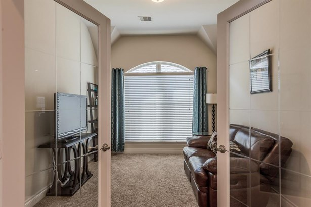 The double glass doors open off the entry into this most flexible room. Currently used for TV watching, this private space could also be used as a formal study, game room, playroom or media room. (photo 5)