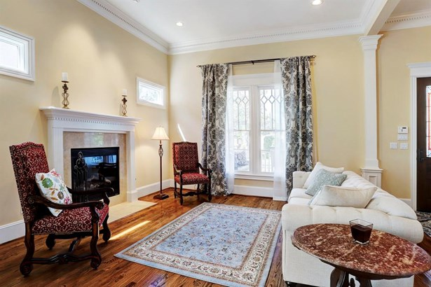 Living room has a gas fireplace and many windows allowing abundant natural light (photo 3)