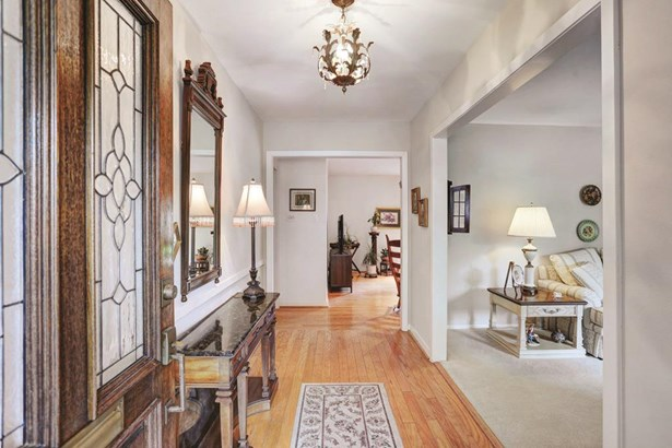 Welcoming entry with hardwood floors and grand formals (photo 2)