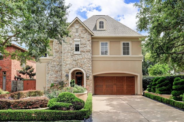 This beautiful home is situated on a quiet street on a double lot in desirable Bellaire!