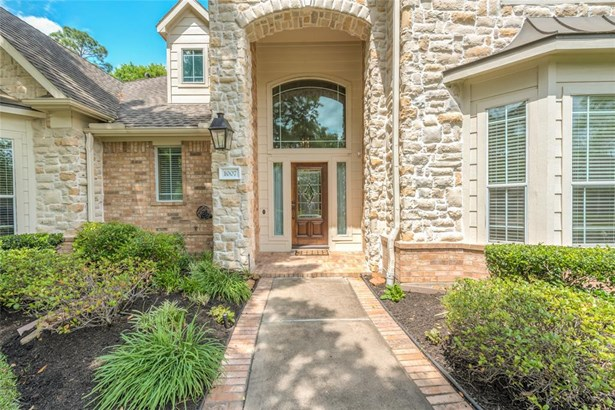 Inviting stone entrance with side lantern and brick lined walkway leading to the wood & glass front door with side lights and huge upper window. (photo 4)