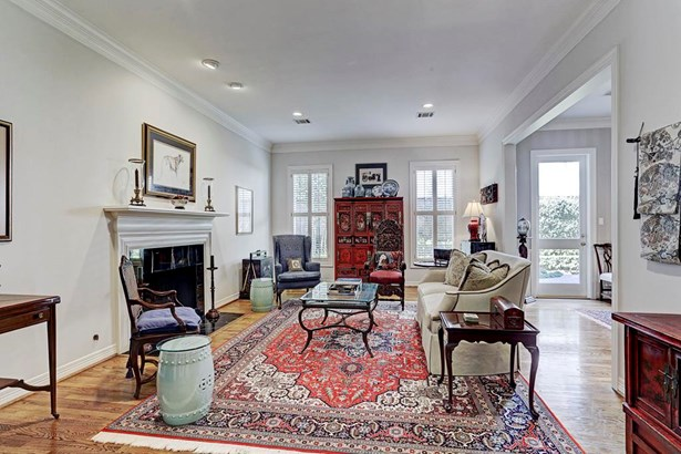 Lovely inviting living area with cozy fireplace overlooking lush garden area. (photo 3)