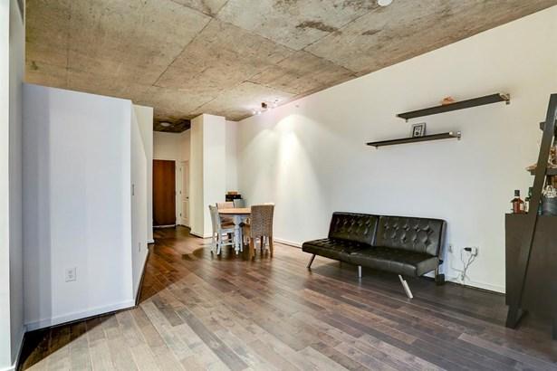 The 11x12 SF living room has two display shelves. (photo 5)