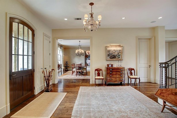 """The tasteful Country French traditional style of the exterior blends with a most handsome and sophisticated interior. One enters into this lovely, oversized entry hall where the 5"""" wide hardwoods spread throughout the downstairs. Beautiful, understated mi (photo 2)"""