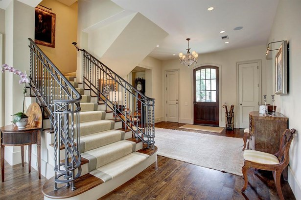 Last view of the beautiful stairway and the entry foyer. Note the really handsome iron stair rail and balustrade. What you will notice quickly is that while the home is more than generous in terms of size and space, it still feels a warmth and intimacy th (photo 4)