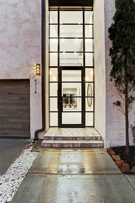 A closer approach of the homes entry. residents & guests are welcomed by a towering wall of glass nearly 20 feet in height. Antique placed brick is carried through the homes reception hall. (photo 2)