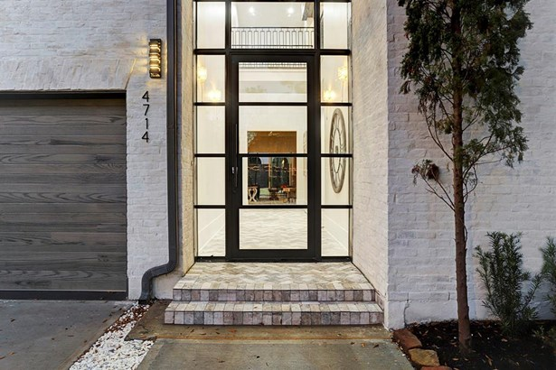 Nearing the entry, the homes artful exteriors speak start to blend with interior spaces, a testament to its architectural prowess and innovative design by Brickmoon Design. (photo 3)