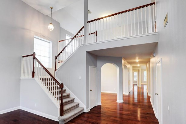 Beautifully appointed staircase which leads to the second floor game room (photo 4)