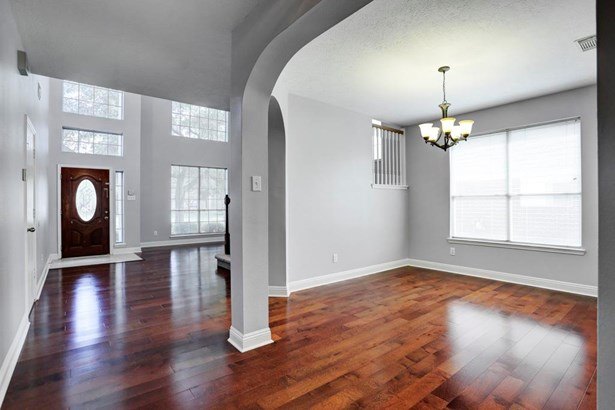 Gleaming wood floors in the formal living and dining areas (photo 5)