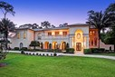 Majestic custom built home on almost an acre backing to lush landscaping and dried ravine. (photo 1)