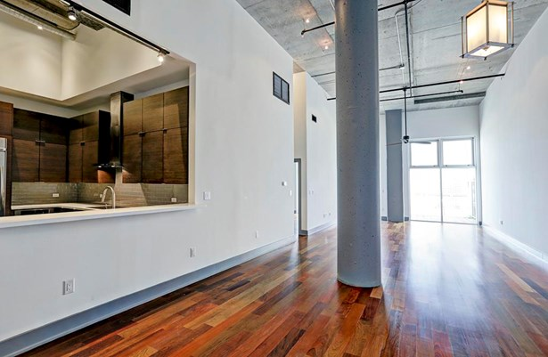 Five inch walnut flooring runs through the main living space and bedroom creating a warm ambiance in this otherwise modern loft. (photo 2)