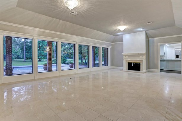 Immediately you enter this grand space! Staged either formally or for casual living, it speaks of the sumptuous capacity, complemented by the spread of the acreage beyond! Notice the wall of windows and the marble flooring, gleaming in the glow of special (photo 4)