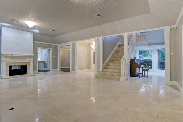 Another view, showing the extra-wide staircase with marble tile. Crisp, clean, elegant. The entry foyer is located to its left. (photo 5)