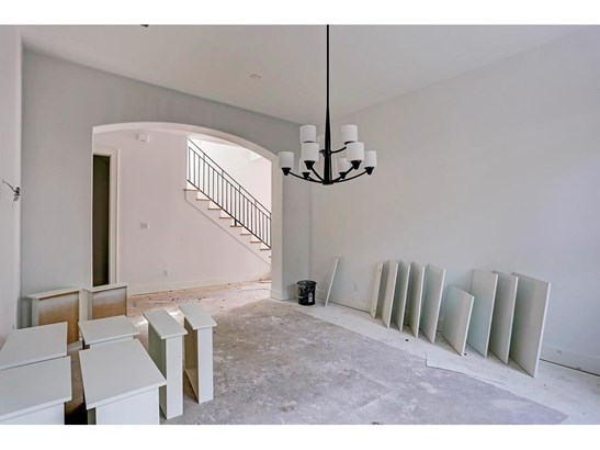 Large formal dining with three large windows that bring in an abundance of natural light. Photos: 9/27 (photo 3)