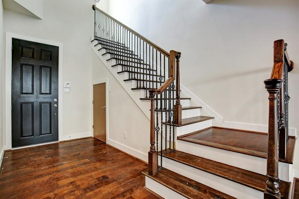 Upon entering the home you and your guests will be greeted at a Solid Mahogany Door, engineered wood floors and iron railing stair case. (photo 4)