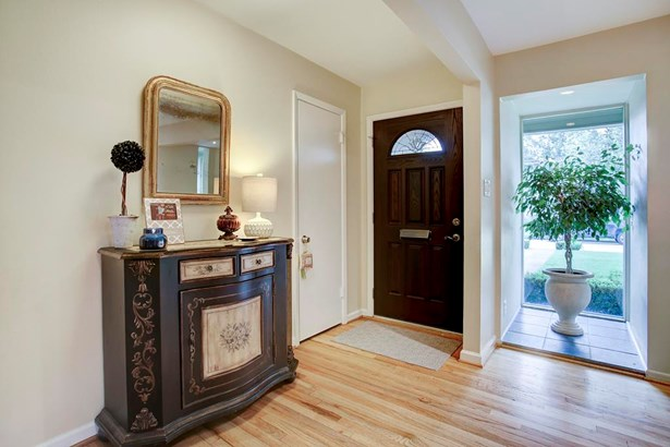 The Entry is gracious, and is open to the public spaces of the home. (photo 4)