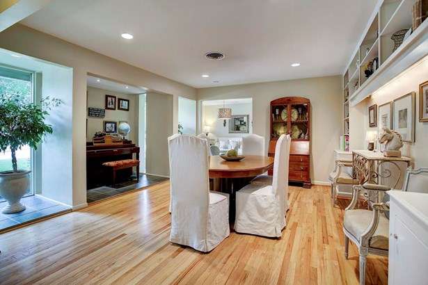The formal Living Room has been turned into the Dining Room. This room features: Hardwood floors, a wall of built-ins and a nook that fits an upright piano. (photo 5)