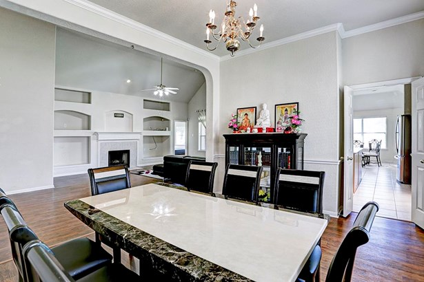 The formal dining room is right off the kitchen; with beautiful hardwood floors, crown molding and chair railing, your guests will not want to leave. (photo 5)