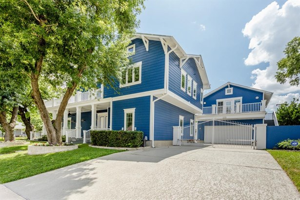 Another view of the outside of the home. The home features a 3 car garage with plenty of storage space. There is also a built out garage apartment that has a full bath and kitchenette. Perfect for any and all your guests! (photo 3)