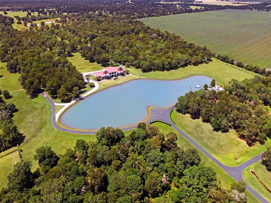 This magnificent custom home nestled on 50+ acres offers a private 3 acre lake and breathtaking panoramic views in every direction. (photo 1)