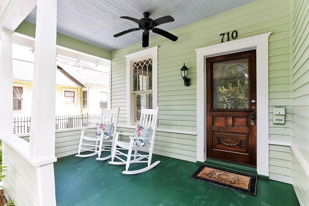 Front porch with vintage front door, mailbox, window detail. This is a very special home, known as the Candy House from neighborhood history. Built in1920, it has been beautifully taken care of and maintained. (photo 4)