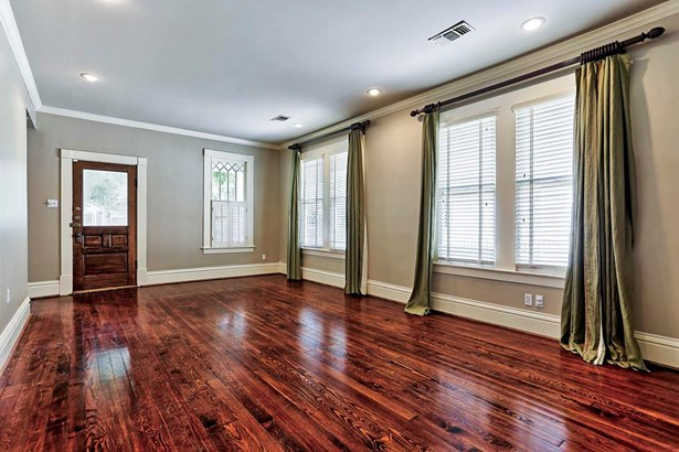 Living/Family Room (20x13) features Antique pine floors, high ceilings which make the entire home feel roomier. There are great windows providing natural light, and a bonus that the house has north/south exposure. (photo 5)