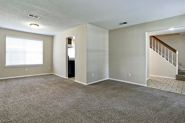 Formal Living, study or gameroom with carpet and neutral colors. (photo 3)
