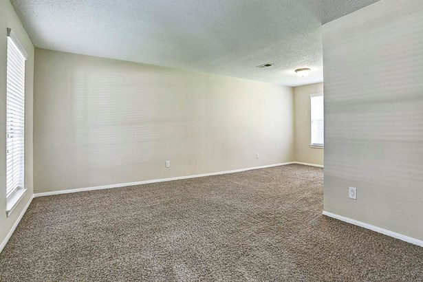 Another view of formal living, study or gameroom. (photo 4)