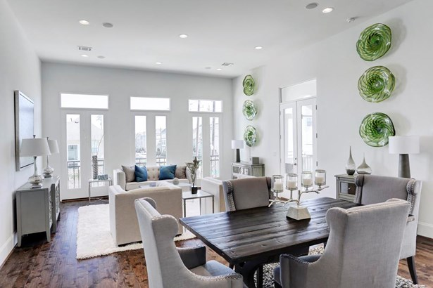 "Natural light pours in the ""Romeo & Juliet"" with transom style windows. Also enjoy outdoor cooking on the large 2nd floor balcony equipped with a gas line for your BBQ. (photo 2)"