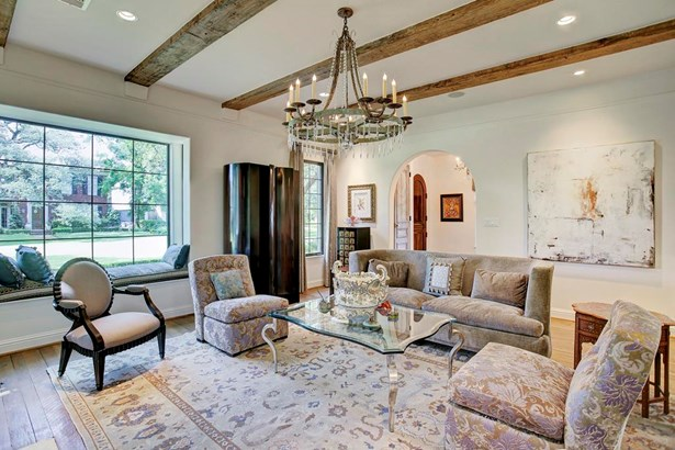 Stunning reclaimed beams and hardwoods adorn the formal living room. This room is both elegant and cozy with a European flair. Light and bright with a beautiful fireplace, attention to detail surrounds you. (photo 5)