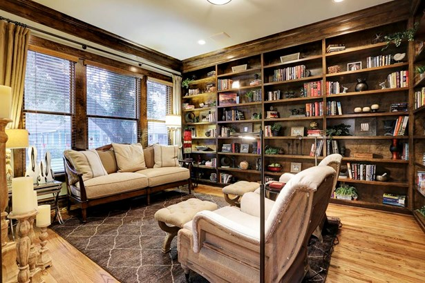 Living Room/Study has 2 walls with floor to ceiling built-in bookshelves and pocket doors for privacy. (photo 4)