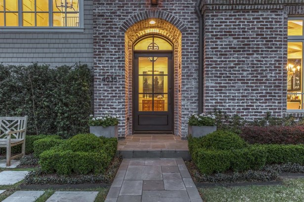 Covered brick lantern front entrance and an inviting divided light metal front door for a glimpse into this wonderful home. (photo 3)